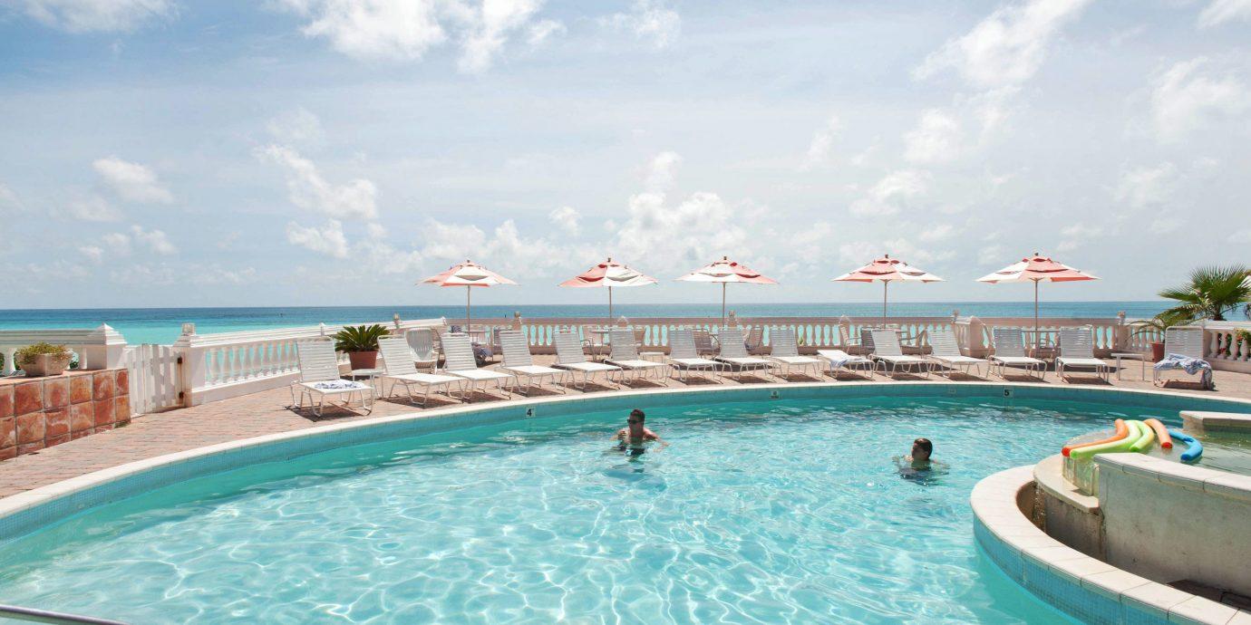 sky water swimming pool leisure Pool Resort swimming Ocean caribbean water sport resort town reef blue Water park Lagoon