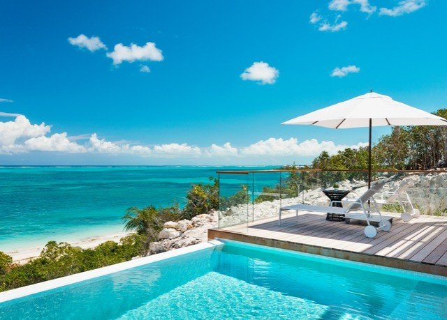sky water umbrella swimming pool chair Pool caribbean property blue leisure Resort reef Lagoon Sea Ocean Villa resort town swimming overlooking day