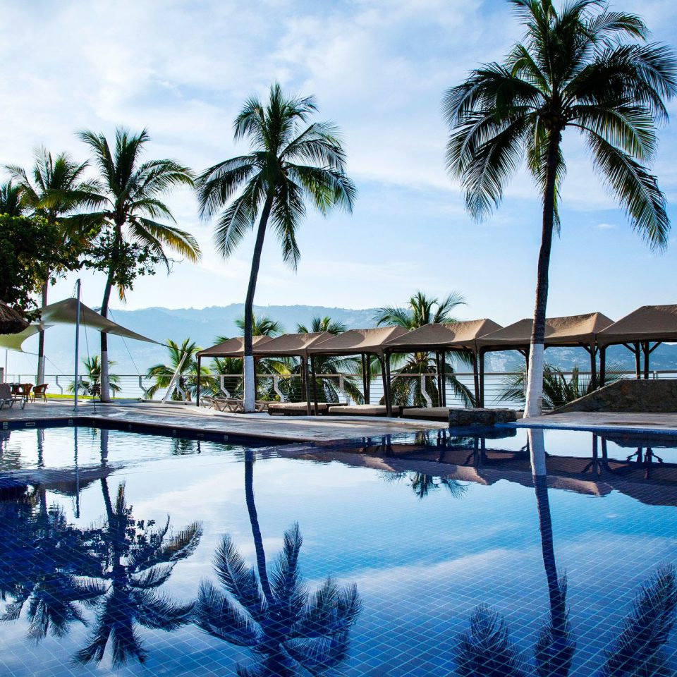 tree sky water palm Resort swimming pool leisure Ocean caribbean Sea lined arecales Lagoon marina Pool condominium shore