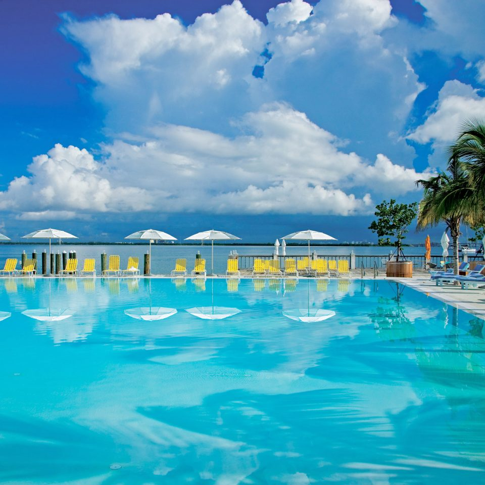 sky water swimming pool leisure Pool Resort caribbean Ocean Sea Lagoon water sport resort town blue swimming day