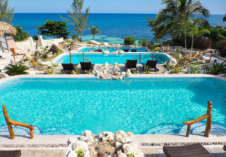 tree water sky swimming pool chair property leisure Resort caribbean Pool Villa Ocean resort town Lagoon Water park blue lawn swimming overlooking