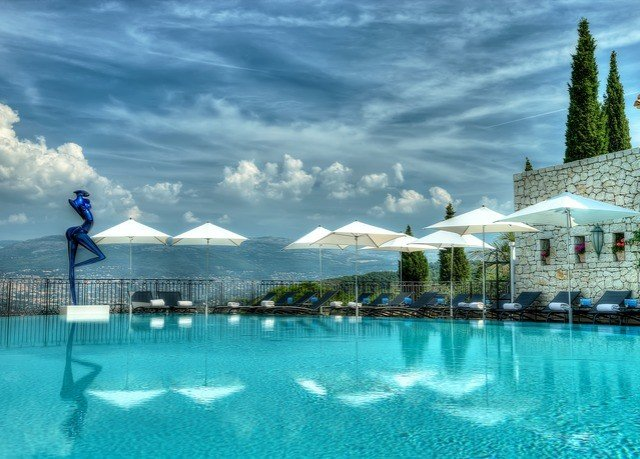 sky water swimming pool scene Sea Ocean Resort blue Lagoon clouds cloudy day