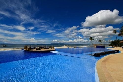 sky water swimming pool horizon Sea blue shore marina dock Ocean Lagoon Resort clouds day