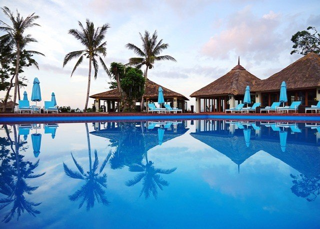 tree sky Resort umbrella swimming pool leisure property Pool resort town palm Lagoon blue caribbean swimming surrounded