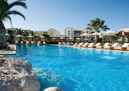 water sky rock Pool swimming pool property Resort leisure resort town condominium Lagoon caribbean swimming