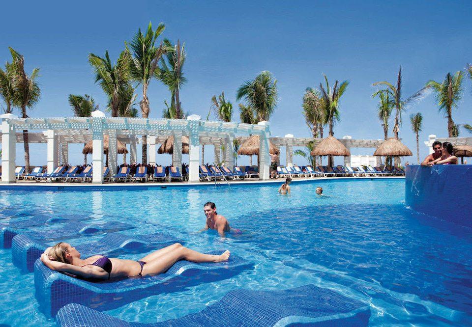 water sky Pool tree leisure swimming swimming pool Resort water sport caribbean blue resort town Water park Sea Lagoon Villa