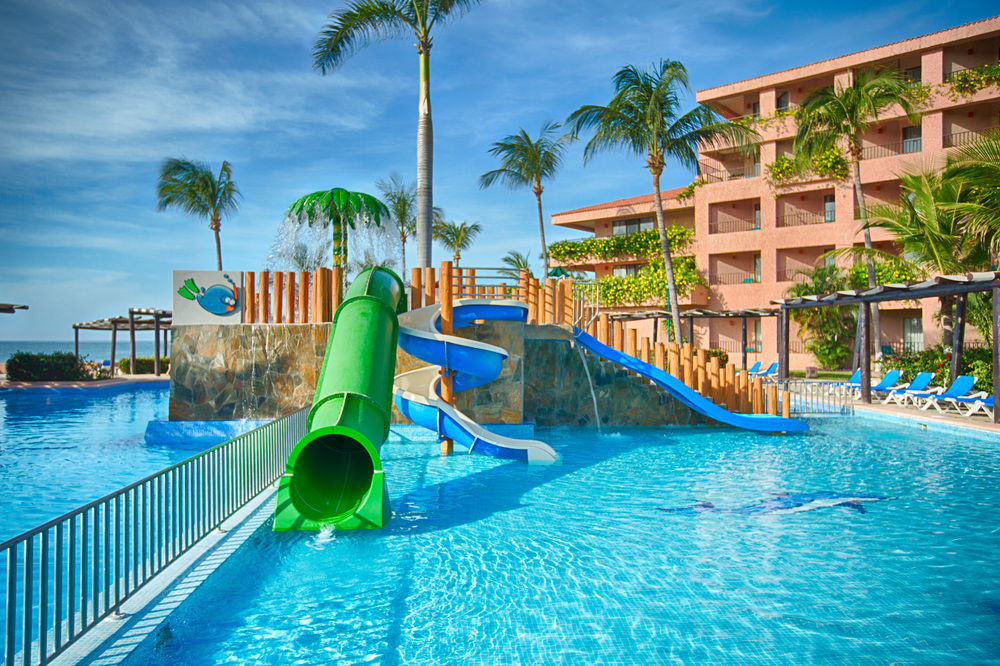 sky water leisure Pool swimming pool Resort Water park amusement park caribbean resort town blue arecales Sea park Lagoon tropics swimming