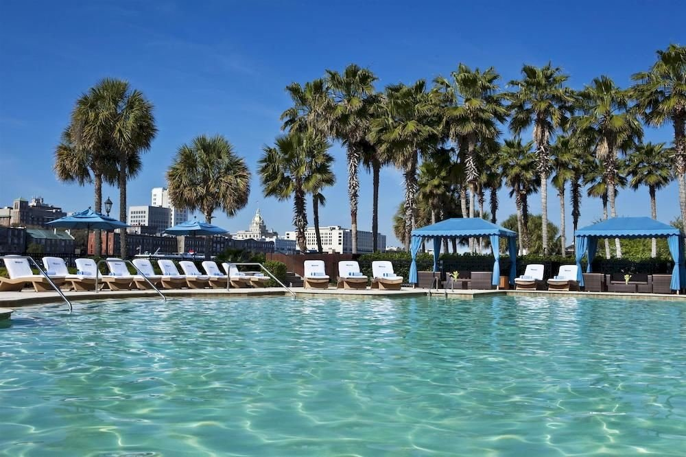sky tree water swimming pool property leisure Resort marina resort town Lagoon caribbean Sea Villa Pool dock palm lined plant swimming shore