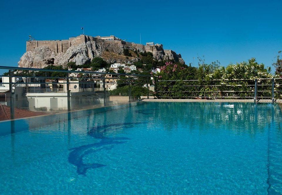 water sky Pool swimming pool Sea resort town Resort Lagoon swimming blue day