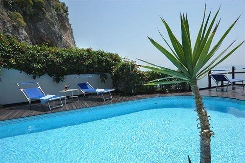 tree swimming pool property leisure Resort Pool caribbean Villa condominium Lagoon blue plant palm surrounded