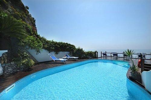 sky water swimming pool property leisure caribbean Resort Pool Villa resort town blue condominium Lagoon swimming