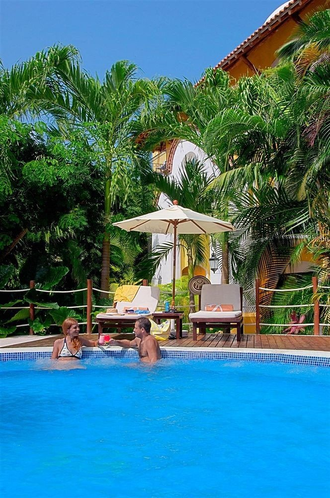 tree water leisure Resort swimming pool property Pool Water park caribbean resort town amusement park swimming Villa blue tropics Village Lagoon surrounded