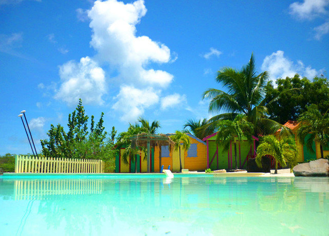sky swimming pool leisure property Resort caribbean arecales Lagoon Pool tropics Villa colorful swimming
