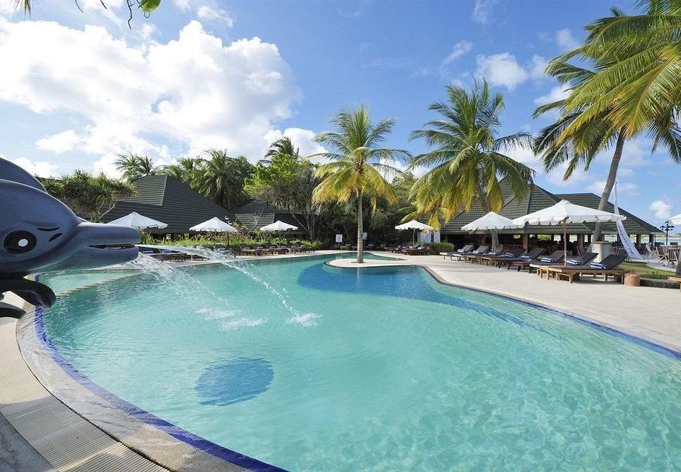 tree sky swimming pool Resort Pool property leisure caribbean palm reef resort town Lagoon Water park Villa swimming