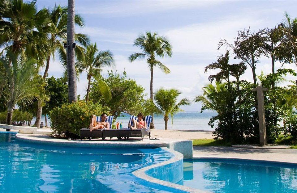 tree water sky Resort Pool swimming pool leisure property palm caribbean arecales swimming resort town Lagoon Villa Water park blue plant