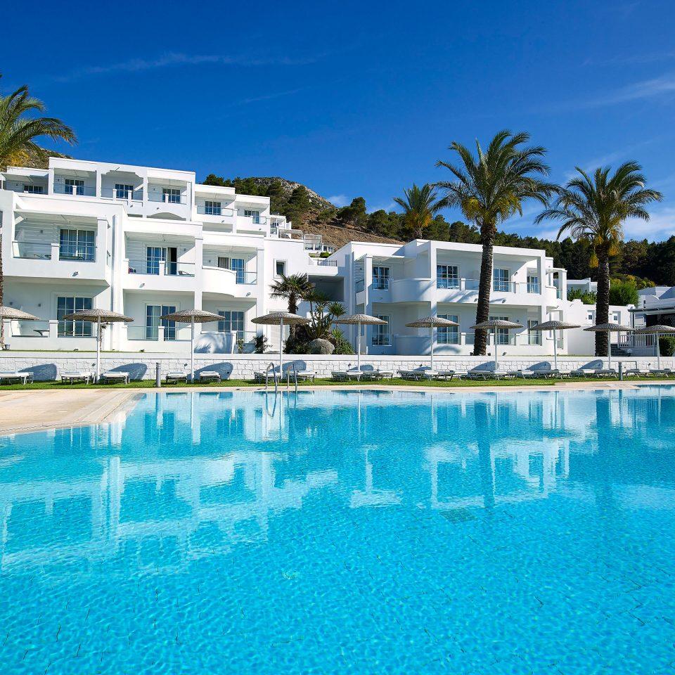sky water Pool swimming pool property Resort leisure condominium marina swimming resort town blue dock Villa Lagoon caribbean