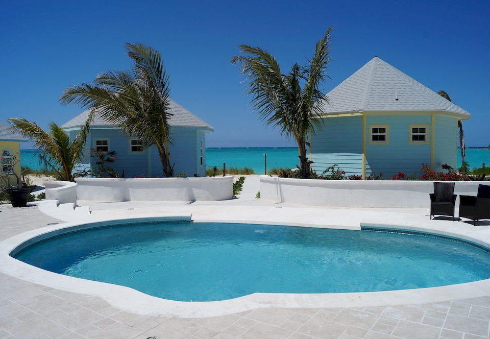 Pool Resort tree water bathtub swimming swimming pool property reef leisure Villa vessel water sport blue caribbean Lagoon round