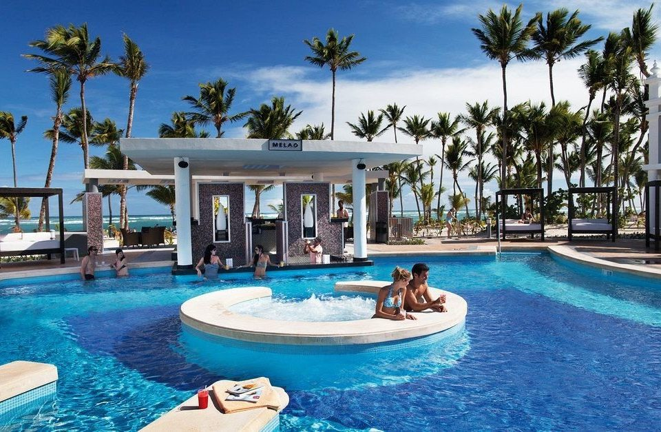 sky Pool water tree Resort swimming swimming pool leisure property blue caribbean Water park resort town Villa water sport Lagoon condominium palm dolphin