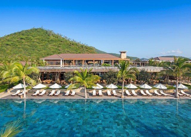 water sky umbrella chair property Resort swimming pool leisure swimming caribbean resort town Villa Lagoon shore Pool lined