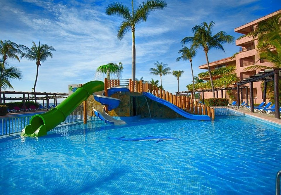 tree sky water Pool amusement park leisure Water park swimming pool palm Resort park swimming resort town recreation Lagoon caribbean