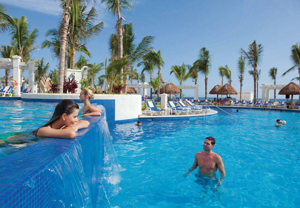 tree sky water Pool leisure swimming pool swimming water sport Resort Water park resort town caribbean Lagoon blue palm