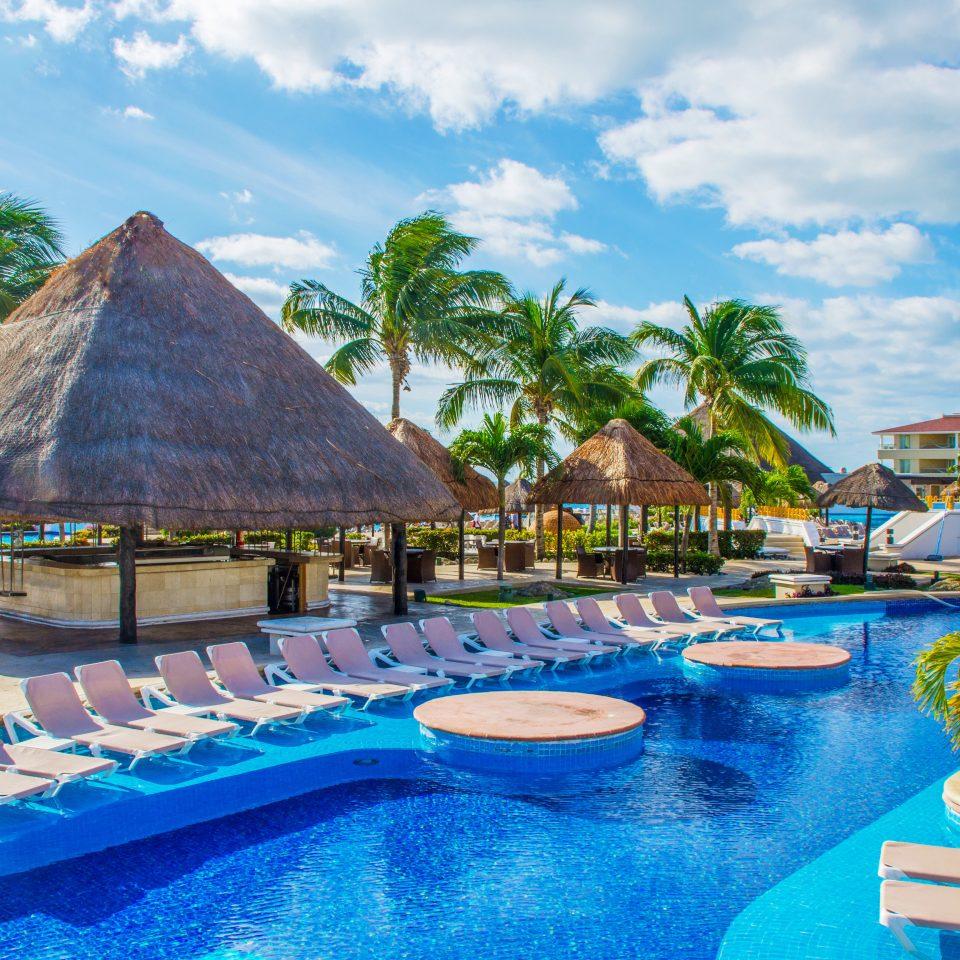 sky water umbrella leisure swimming pool Resort Pool amusement park Water park caribbean blue resort town swimming park Lagoon colored