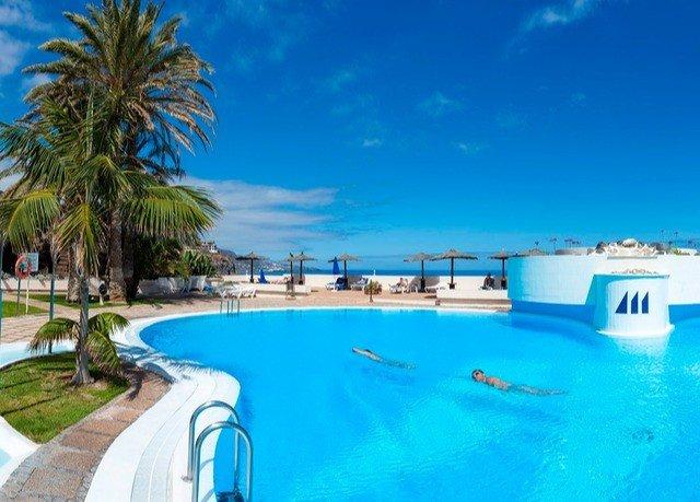 water sky Pool swimming pool property leisure Resort caribbean swimming Lagoon Water park resort town palm lined