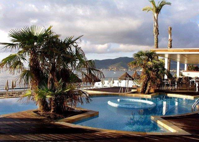 tree sky swimming pool property Resort palm arecales caribbean Villa Lagoon condominium shore
