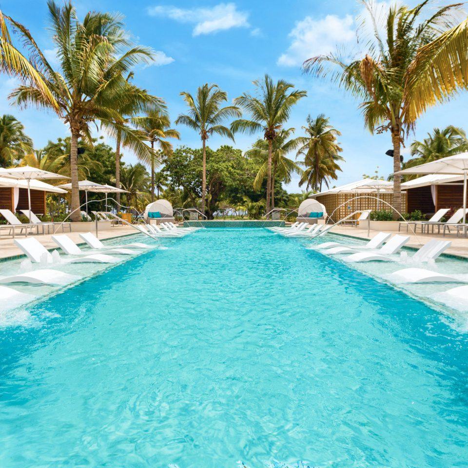 Resort swimming pool leisure property resort town caribbean palm tree Villa arecales tropics water leisure centre Lagoon