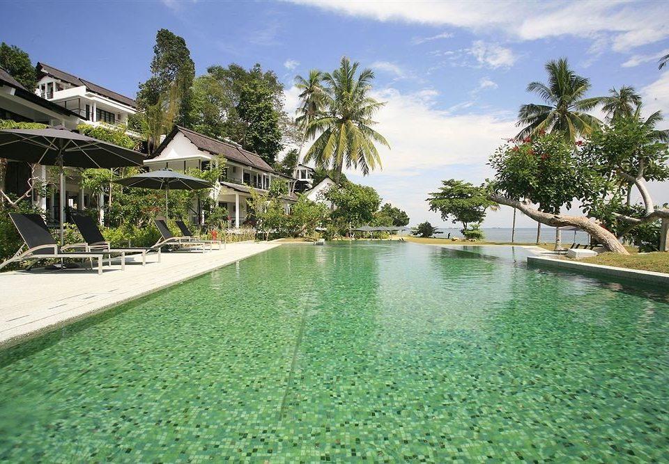 sky tree property swimming pool Resort green Villa mansion condominium Lagoon plant shore day