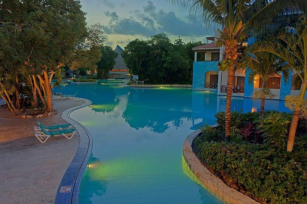 tree swimming pool leisure property Resort resort town plant Water park mansion Lagoon Villa backyard