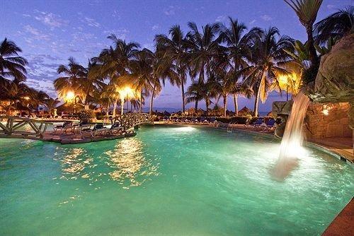 water tree leisure Resort swimming pool palm caribbean resort town Lagoon Water park night shore