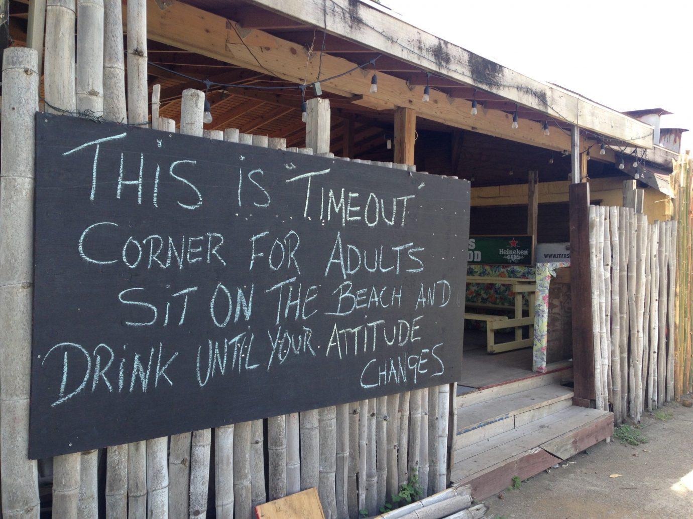 Food + Drink Trip Ideas Fence outdoor wooden sign wall blackboard art