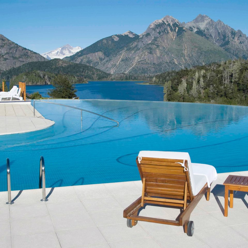 Lounge Mountains Natural wonders Nature Outdoor Activities Outdoors Patio Pool Resort mountain sky leisure swimming pool Lake Villa
