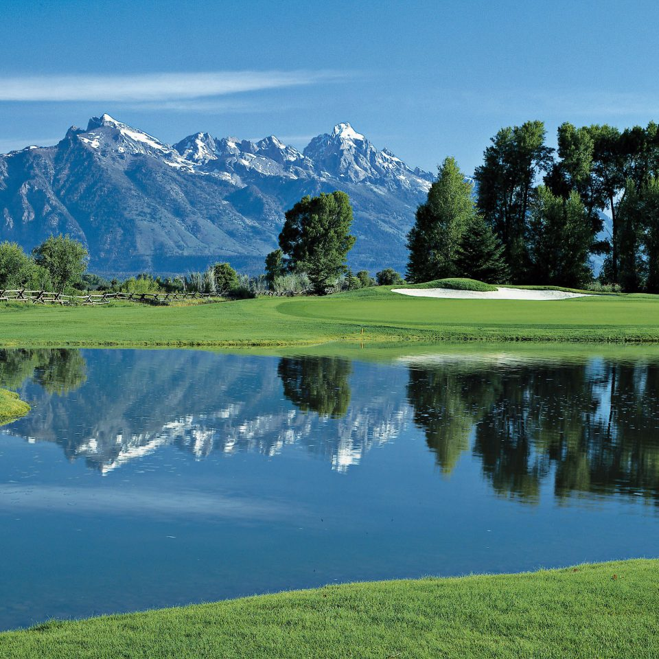Lake Mountains Scenic views sky tree grass mountain water Nature structure grassland sport venue golf course outdoor recreation hill sports mountain range reservoir meadow landscape golf club recreation pond overlooking pasture lush hillside surrounded land highland