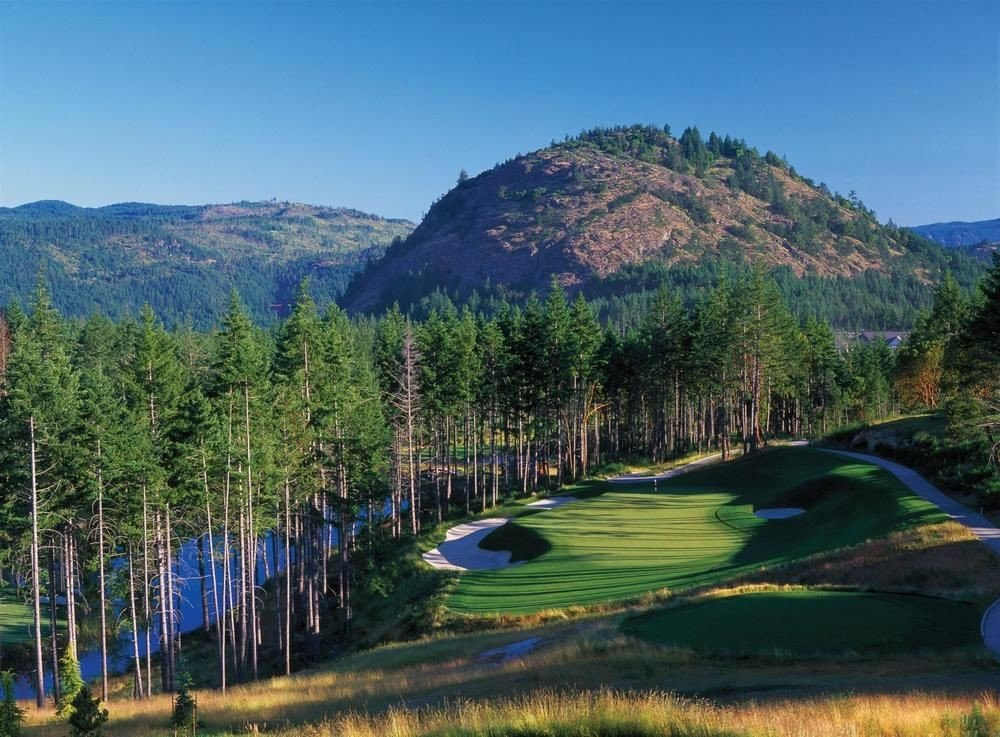 grass mountain sky tree mountainous landforms wilderness ecosystem Nature sport venue green Lake hill mountain range landscape meadow valley lush plateau golf course agriculture grassy surrounded hillside highland