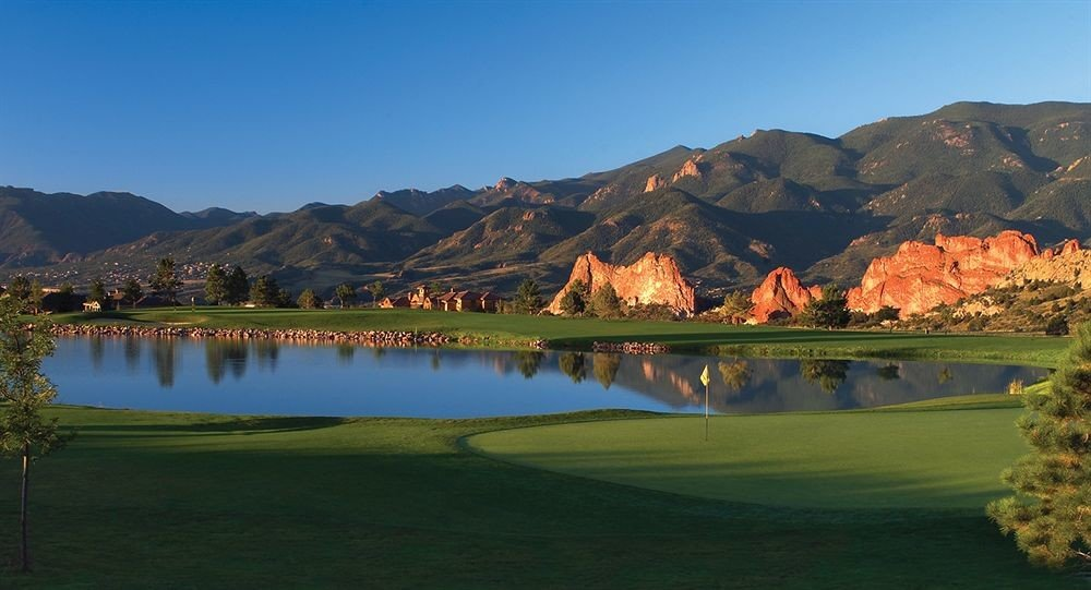 grass mountain sky Nature structure sports sport venue golf course outdoor recreation Lake recreation mountain range golf club loch plateau highland