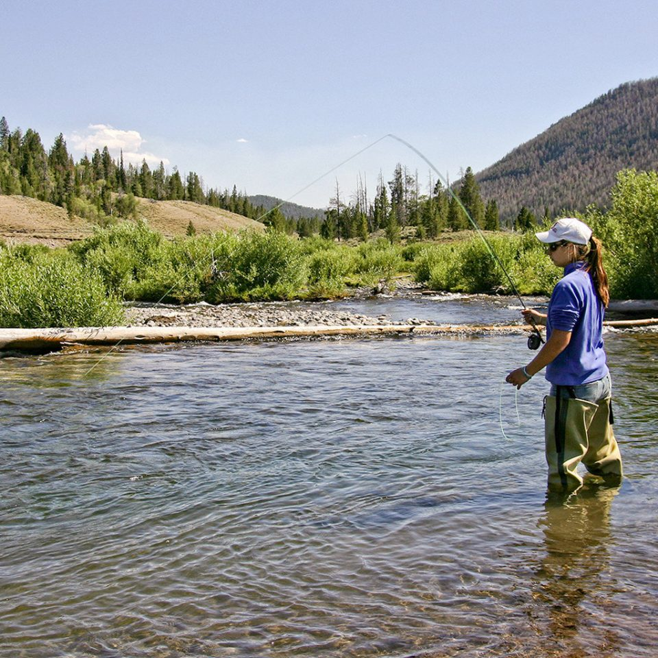 Nature Outdoor Activities Outdoors Ranch Scenic views sky water fishing man mountain fly fishing wilderness River recreational fishing Sport outdoor recreation recreation Lake angling