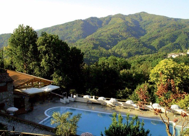 mountain tree sky water Nature property River Lake swimming pool Resort Villa Village surrounded shore lush hillside
