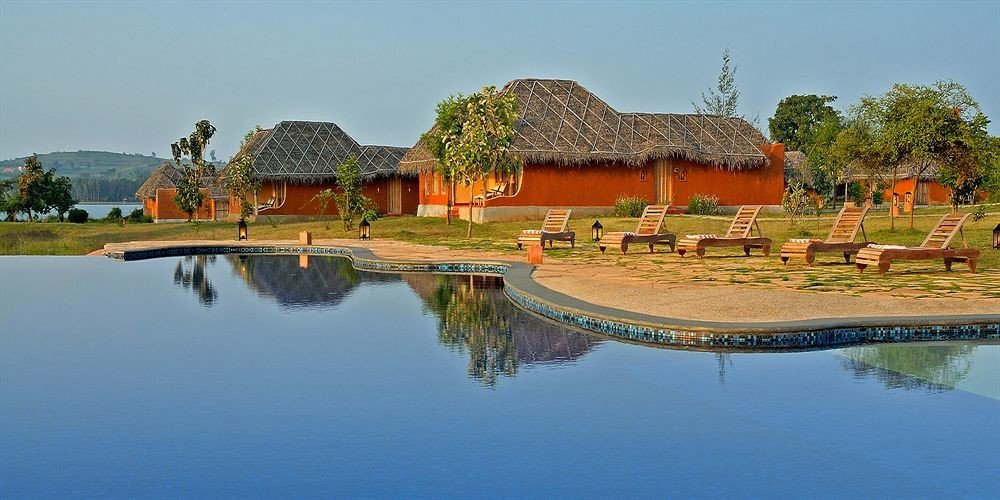 water sky house Nature Village Lake pond Resort swimming pool surrounded traveling