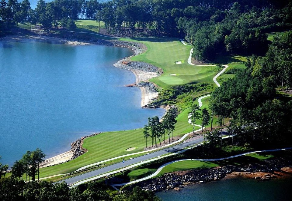 tree water grass River structure Nature Lake aerial photography green sport venue pond reservoir golf course landscape golf club hillside lush overlooking surrounded wooded