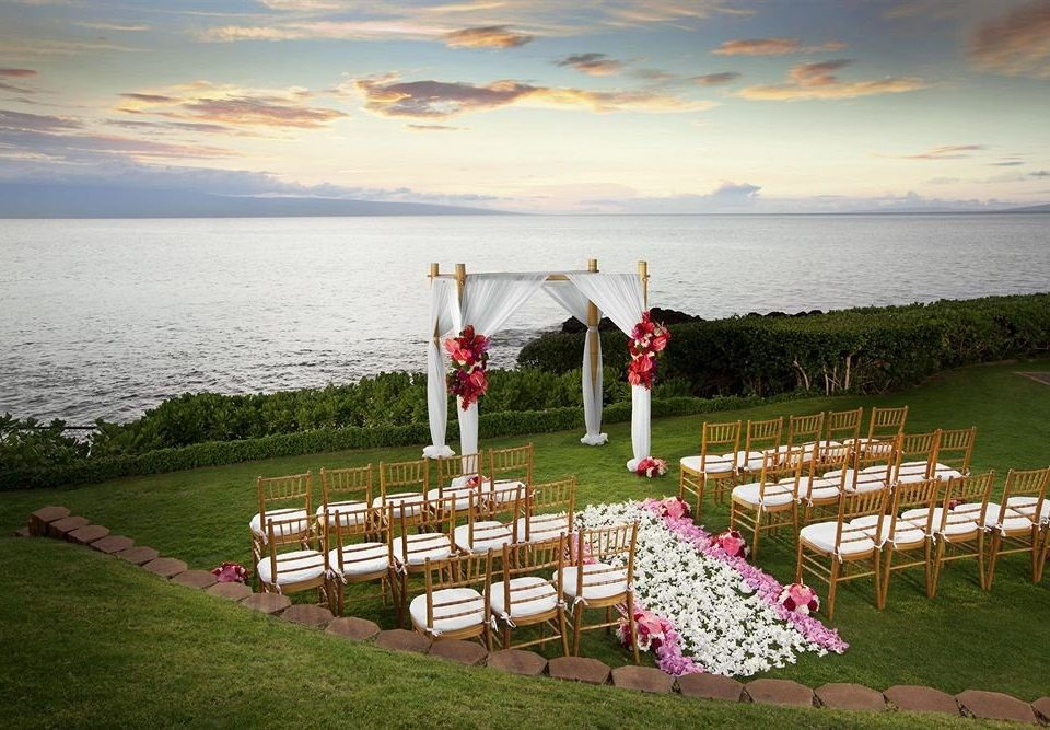 grass sky water overlooking ceremony wedding Ocean flower Lake shore