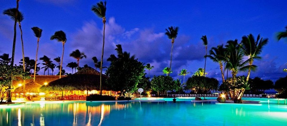 tree water sky palm Resort swimming pool night arecales dusk Lake lined surrounded