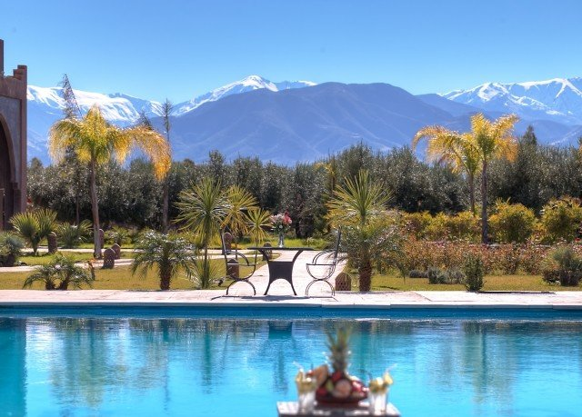 sky water tree mountain leisure swimming pool Resort Lake Villa surrounded