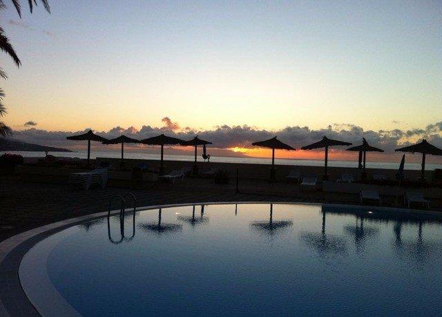 sky Sun horizon Sunset dusk morning evening dawn sunrise marina dock Sea Lake clouds day shore