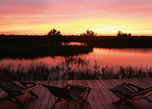 sky bench Sunset water grass sunrise Sun afterglow dawn overlooking red sky at morning morning dusk evening wooden Lake setting surrounded field