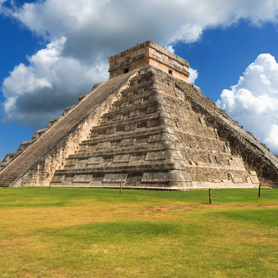 Landmarks Monuments Museums Outdoor Activities Ruins grass sky maya civilization monument landmark historic site archaeological site building pyramid field grassy ancient history badlands stone barn day lush