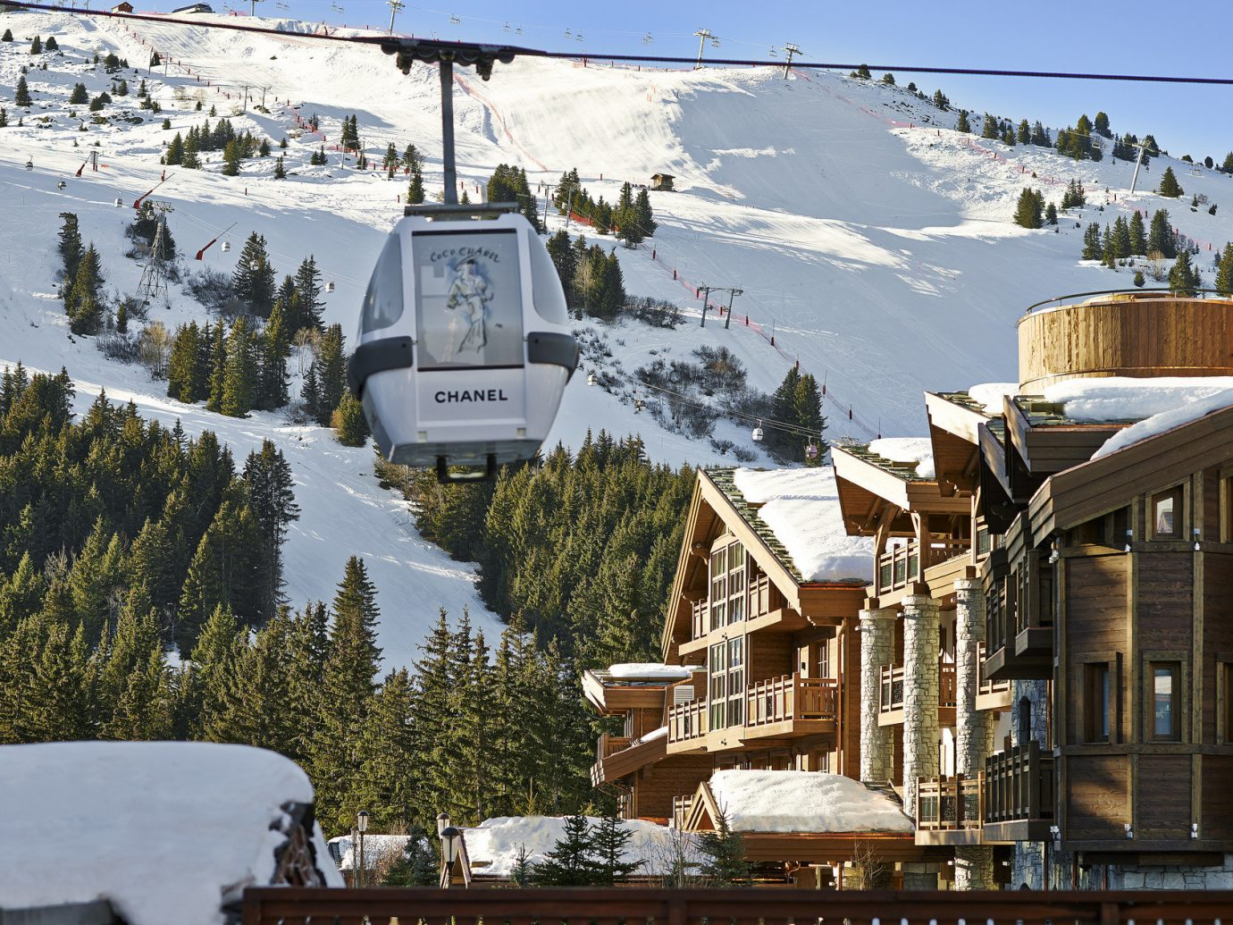 building Cabin Exterior Greenery Hotels Lodge Luxury Travel remote Rustic ski lift ski lodge snow trees Winter outdoor tree sky transport Town weather season Resort residential area rolling stock mountain mountain range vehicle
