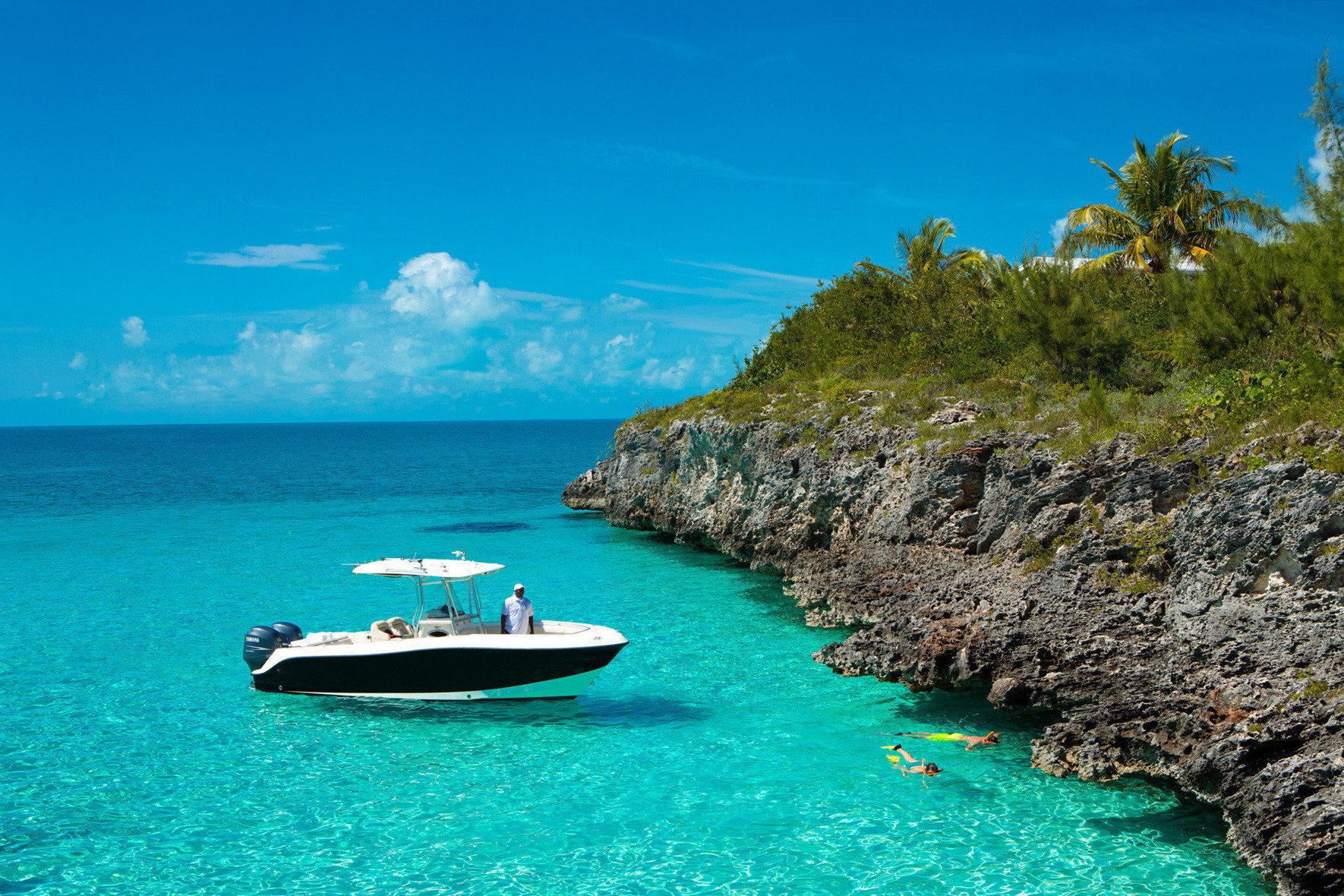 Hotels water outdoor sky Sea landform Boat geographical feature shore Coast Ocean archipelago vacation bay caribbean Island islet Beach Lagoon cove swimming pool cape vehicle tropics terrain day