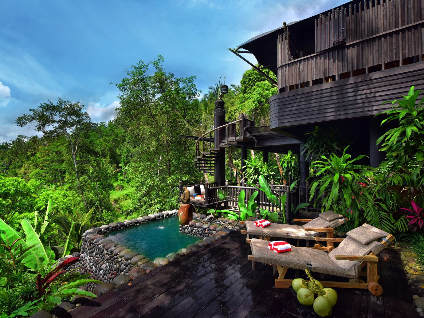 Hotels Outdoors + Adventure vegetation plant leisure water tree Resort landscape estate real estate Jungle backyard swimming pool house cottage sky outdoor structure rainforest Villa landscaping